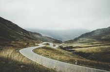 Free Curvy Road Through Mountains Royalty Free Stock Images - 82952169