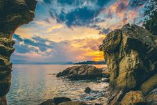 Free Dramatic Sunrise Over The Sea Framed By Rocks Stock Images - 82952884