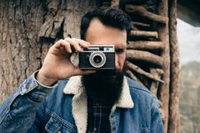 Free Man Taking Picture With Retro Camera Stock Photos - 82952943