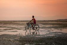 Free Man On Bike At Sunset Royalty Free Stock Photography - 82953547