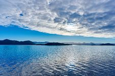 Free White Clouds Over Rocky Coastline Royalty Free Stock Photo - 82953925