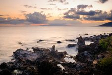 Free Cloudy Sunset Over Ocean And Rocky Shore Time Lapse Photo Royalty Free Stock Images - 82954079