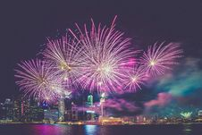 Free Purple And White Fireworks In The High Buildings Stock Photography - 82954672