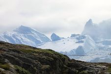 Free Green Grass Covered Mountain Next To Snow Covered Mountain During Daytime Stock Photos - 82954723
