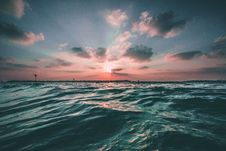 Free Sunset With Clouds And Water Royalty Free Stock Photography - 82954757
