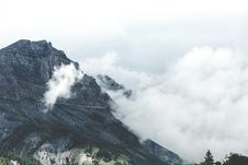 Free Mountain Summit In Clouds Stock Images - 82955224