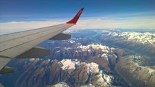 Free Airplane Wing Over Snow Capped Peaks  Stock Images - 82955244