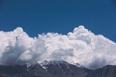 Free Brown Mountain Near Clouds Photo Stock Photo - 82956100
