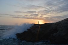 Free Person On Rocky Coastline At Sunset Royalty Free Stock Photography - 82956577