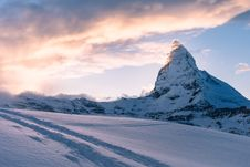 Free Snowy Mountains Landscape At Sunset Royalty Free Stock Image - 82956596