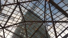 Free Skyscraper Viewed Through Glass Roof Royalty Free Stock Image - 82956606