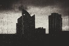 Free Urban Skyline Through Rainy Window Stock Image - 82956761