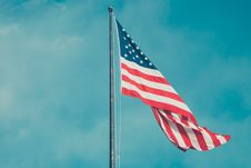 Free American Flag Against Blue Skies Royalty Free Stock Photography - 82957187