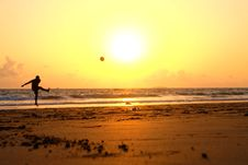 Free Man Playing Ball On Shoreline At Sunrise Stock Photo - 82957360