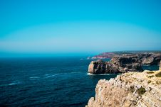 Free Cliffs On Rocky Coastline With Blue Sky Stock Photos - 82957473