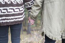 Free Couple Walking Hand N Hand Royalty Free Stock Image - 82957616