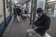 Free Man In Black Jacket Sitting At The Train Station Stock Photo - 82958060