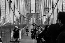 Free Grayscale Photo Of People Walking On A Bridge During Daytime Stock Image - 82958501