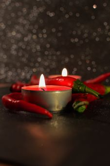 Free Candles And Chili Peppers Royalty Free Stock Photography - 82958687