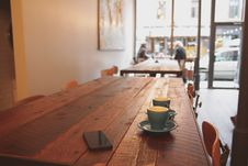 Free Coffee Shop With Cups On Table Stock Photography - 82958842