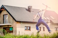 Free Construction Worker Jumping Outside Home Royalty Free Stock Image - 82958956