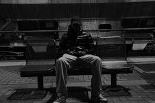 Free Man On City Bench Royalty Free Stock Image - 82959166