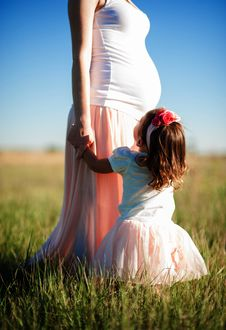 Free Mother Holding Her Child S Hand On Green Grasses Stock Images - 82959224