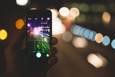 Free Smartphone Against Urban Bokeh Royalty Free Stock Photos - 82959448
