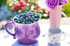 Free Black Berries On Purple Container Beside White And Purple Floral Mug Royalty Free Stock Photo - 82959745