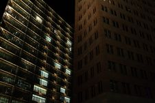 Free Brown Concrete Building Beside Black Concrete Building During Night Time Royalty Free Stock Image - 82960106