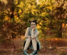 Free Young Woman Sitting Beside Trees In Autumn Stock Photo - 82960120