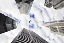 Free Plane Over Skyscrapers Royalty Free Stock Image - 82960126