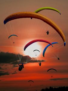 Free People Riding Parachutes During Sunset Royalty Free Stock Images - 82960229