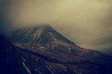 Free Fog Over Mountain Peak Stock Photo - 82960270