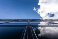 Free Blue Skies And Clouds Reflecting In Modern Building Stock Images - 82960344