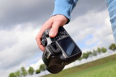 Free Person Carrying Digital Camera Outdoors Stock Photography - 82960672