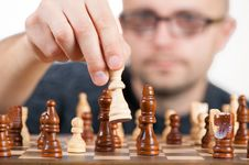 Free Man Holding Chess Piece Royalty Free Stock Photos - 82960798