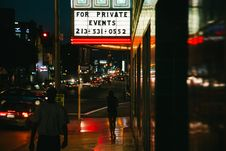 Free Person Walking On Side Walk During Night Time Stock Photography - 82960902