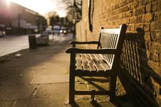 Free Brown Wooden Bench On The Side Of The Road Royalty Free Stock Images - 82961329