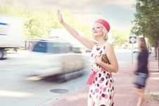 Free Fashionable Woman Hailing Taxi Cab Stock Photography - 82961412