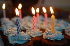 Free Lighted Candles On Cupcakes Royalty Free Stock Images - 82962049