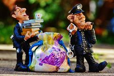Free Cop And Official With Sack Of Money Stock Photos - 82962213