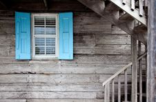 Free Wooden Cabin With Blue Shutters Royalty Free Stock Photos - 82962788
