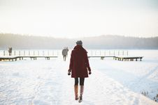 Free Woman Walking In Snowy Landscape Stock Photography - 82962992