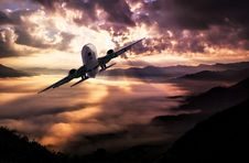 Free Airplane Flying Under White Clouds During Night Time Stock Image - 82963251