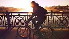 Free Man Cycling Over River Bridge Royalty Free Stock Images - 82963629