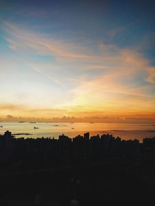 Free Sunset Over Silhouetted City Skyline Royalty Free Stock Photos - 82963758