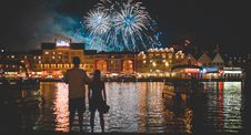 Free Man In White Shirt Beside Woman Watching Fire Works During Night Time Royalty Free Stock Photo - 82964085