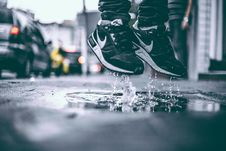 Free Feet Jumping In Puddle Stock Photos - 82964203