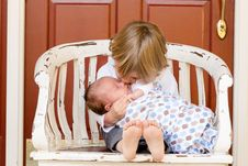 Free Young Boy Cuddling Baby Brother Stock Image - 82964351